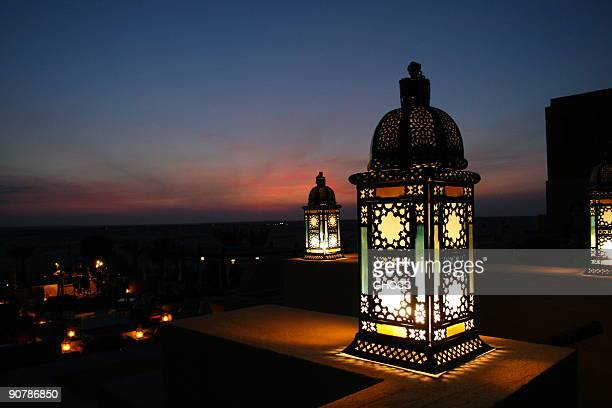 lantern in the desert - arabic script stock pictures, royalty-free photos & images