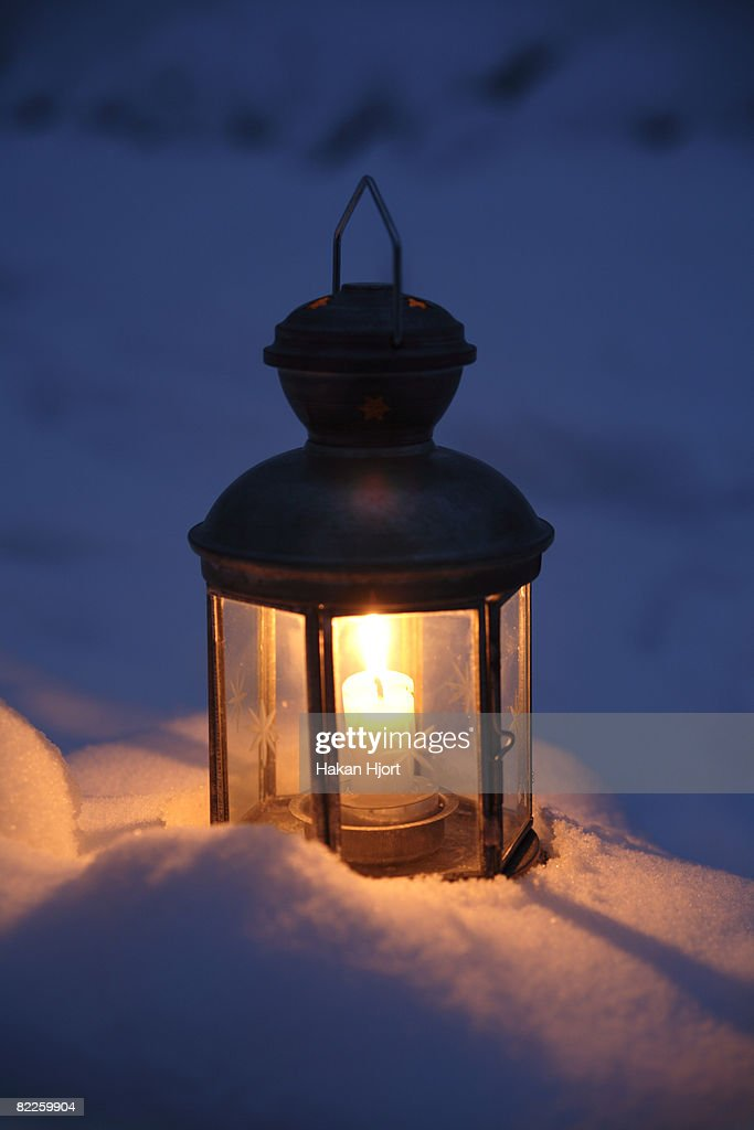 A lantern in the snow Sweden. : Stock Photo