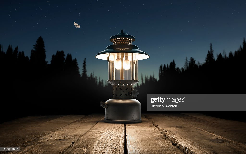 Lantern on a picnic table in the forest : Stock Photo
