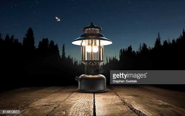 Lantern on a picnic table in the forest