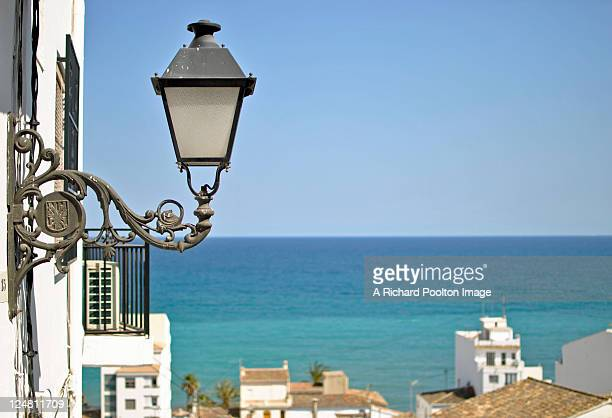 Lantern on wall and sea