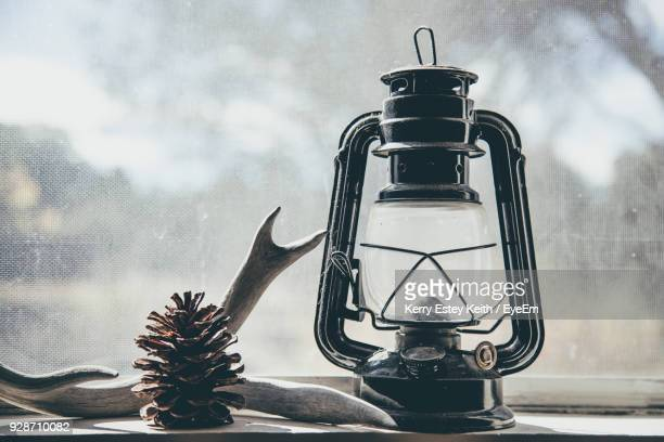 lantern with antler on window sill - kerry estey keith stock photos and pictures