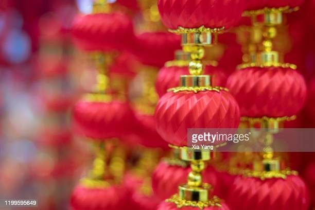 lantern with chinese words - chinese lantern festival stock pictures, royalty-free photos & images