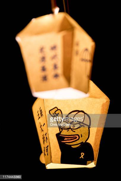 A lantern with Pepe the Frog printed on it is seen during a prodemocracy human chain and lantern rally on Victoria Peak on September 13 2019 in Hong...