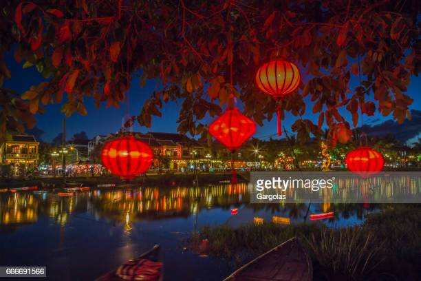 lanterns and colorful lights on river in hoi an, vietnam - vietnam stock pictures, royalty-free photos & images