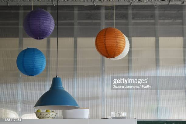 lanterns and pendant light hanging at home - pendant light stock pictures, royalty-free photos & images
