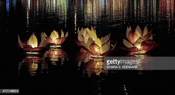 Lanterns are lit at the Gangaramaya Buddhist Temple during the annual Buddhist festival of Vesak in Colombo on May 4 2015 Sri Lankan Buddhists are...