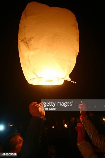 Lanterns are released into the night sky from the BirkenheadGlenfield cemetery in memory of Blessie Gotingco on May 31 2014 in Auckland New Zealand...