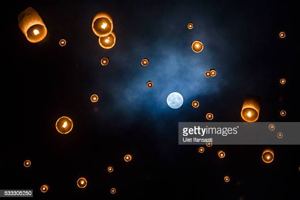 Lanterns fly into the air at Borobudur temple during celebrations for Vesak Day on May 21 2016 in Magelang Central Java Indonesia Vesak is observed...