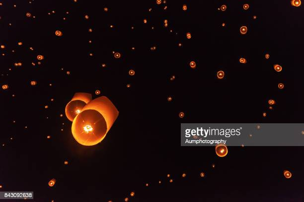 lanterns, forming in the heart shape, were floating in the sky. - national day of prayer stock photos and pictures