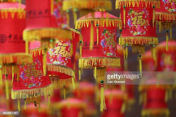 Lanterns hang above the street in China Town on January 30, 2014 in London, England. The Chinese Lunar New Year of Horse, also known as the Spring...