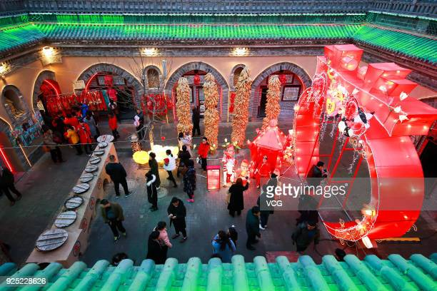 Lanterns illuminate underground cave dwellings to welcome Chinese Lantern Festival at Shanzhou District on February 27, 2018 in Sanmenxia, Henan...