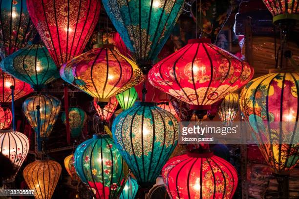 lanterns illuminated at night in hoi an , vietnam . - chinese lantern lily stock pictures, royalty-free photos & images