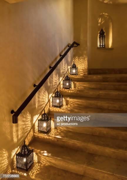 Lanterns illuminating staircase
