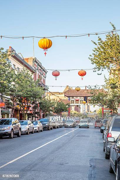 lanterns over street - victoria canada stock pictures, royalty-free photos & images