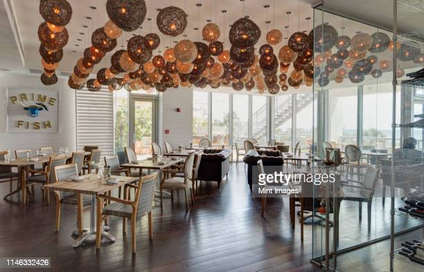 lanterns over tables in restaurant - southeast stock pictures, royalty-free photos & images