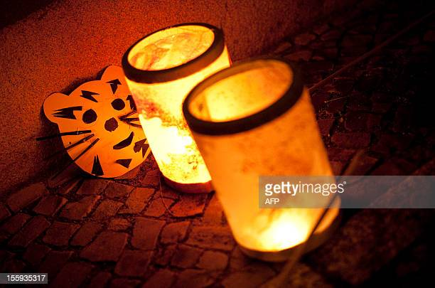 Lanterns stand on the pavement during a St Martin's Day procession on November 9 2012 in Berlin Children in Germany traditionally celebrate the St...
