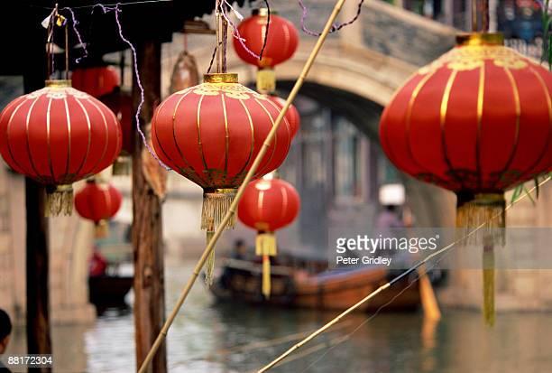 Lanterns, waterway, boats and stone bridge, Zhouzhuang, Jiangsu province, China