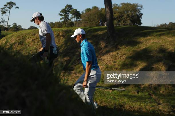 Lanto Griffin of the United States and Jordan Spieth of the United States walk to the fifth tee during the second round of the Houston Open at...
