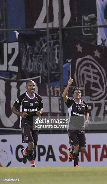 Lanus' Carlos Araujo celebrates his goal against Olimpia during their Copa Libertadores football match in Asuncion Paraguay on February 23 2012 AFP...