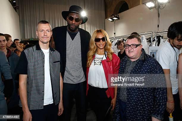Lanvin men fashion designer Lucas Ossendrijver, Basketball player, Amar'e Stoudemire with his wife Alexis and Fashion Designer Alber Elbaz pose...