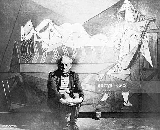 Lanz FrancePhotograph of Pablo Picasso in front of one of his paintings