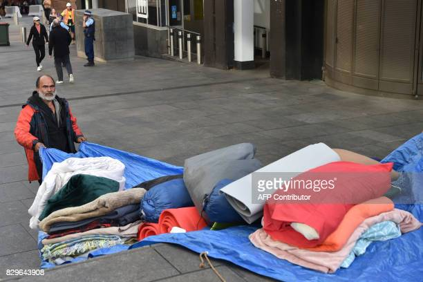 Lanz Priestley who has been dubbed the mayor of 'Tent City' packs up his belongings in Martin Place which has become known as 'Tent City' in the...