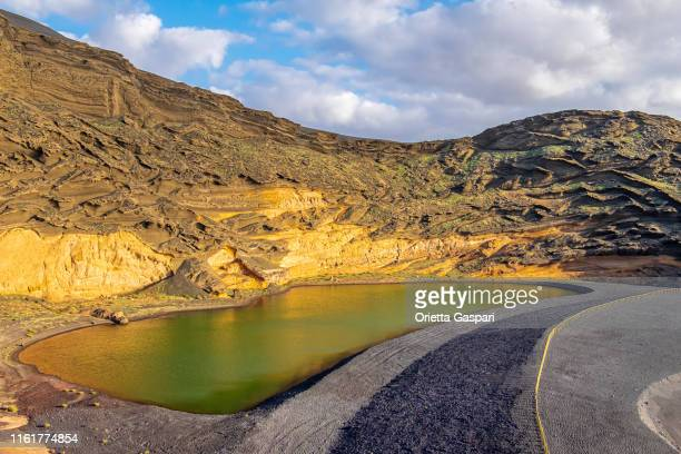 lanzarote, canary islands - charco de los clicos - national park stock pictures, royalty-free photos & images