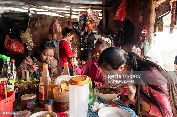 CONTENT] Lao School Girls Eat Noodles In A Local Noodle Shop Before School Phongsali Northern Laos