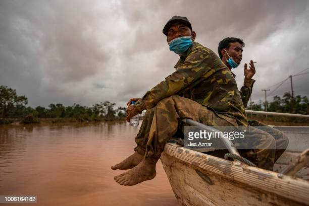 Lao soldiers participate in the rescue of affected villagers after a dam collapsed, on July 27, 2018 in Sanamxai, southeastern Laos. At least 27...