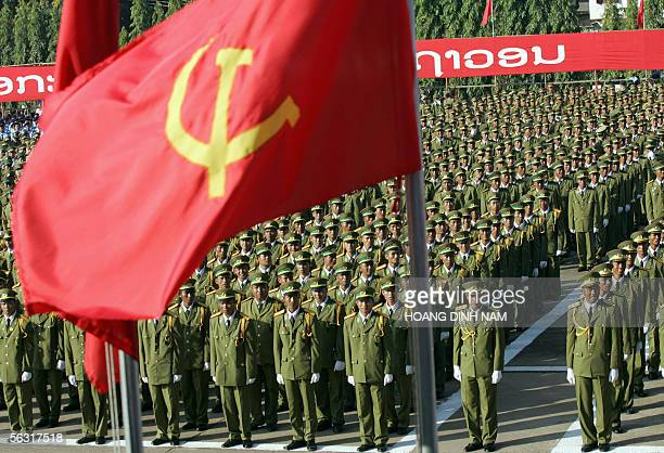 Lao soldiers stand at attention as they listen to the speech of Laos' People's Revolutionary Party Chairman Khamtay Siphandone during the official...