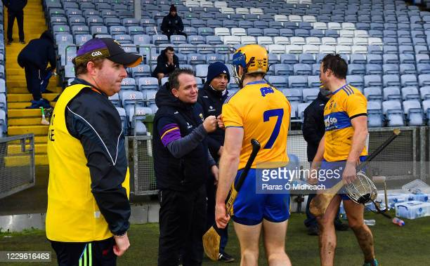 Laois , Ireland - 14 November 2020; Wexford manager Davy Fitzgerald is greeted by Seadna Morey of Clare after the GAA Hurling All-Ireland Senior...
