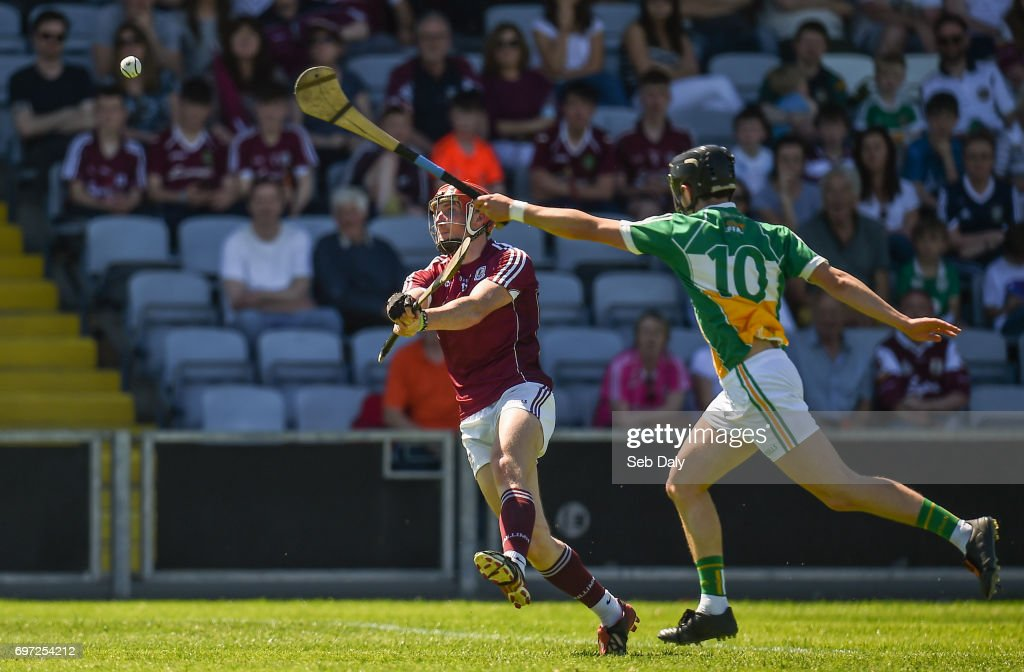 Laois , Ireland - 18 June 2017; Conor Whelan of Galway scores a point while under pressure from Pádraic Guinan of Offaly during the Leinster GAA Hurling Senior Championship Semi-Final match between Galway and Offaly at O'Moore Park in Portlaoise, Co Laois.