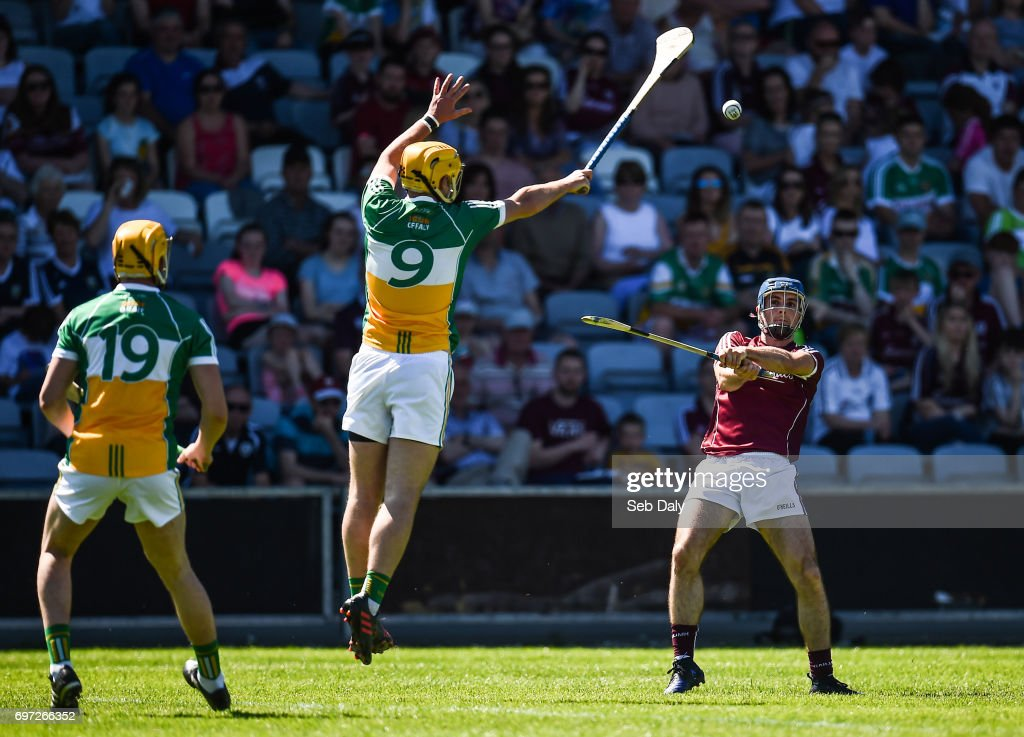 Laois , Ireland - 18 June 2017; Johnny Coen of Galway scores a point despite the attention of Shane Kinsella of Offaly during the Leinster GAA Hurling Senior Championship Semi-Final match between Galway and Offaly at O'Moore Park in Portlaoise, Co Laois.