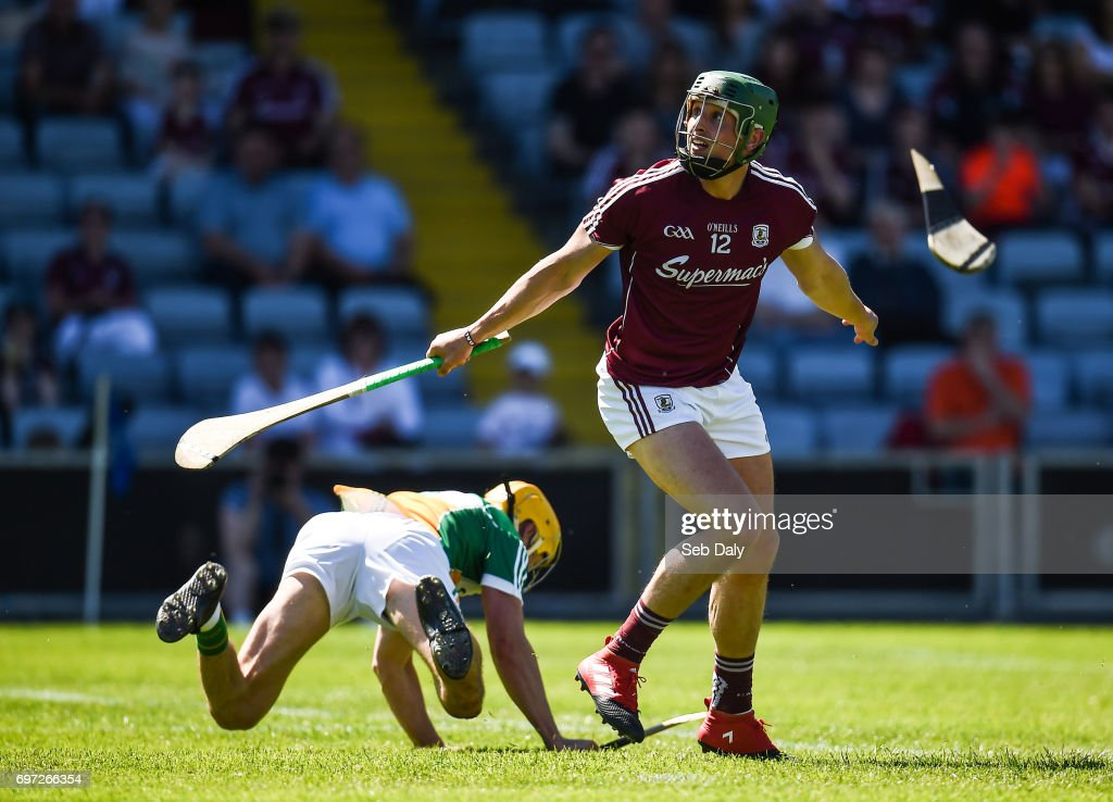 Laois , Ireland - 18 June 2017; Niall Burke of Galway scores a point while under pressure from Paddy Murphy of Offaly during the Leinster GAA Hurling Senior Championship Semi-Final match between Galway and Offaly at O'Moore Park in Portlaoise, Co Laois.