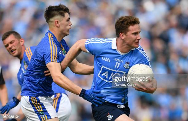 Laois Ireland 27 May 2018 Ciaran Kilkenny of Dublin is tackled by Saoirse Kearon of Wicklow during the Leinster GAA Football Senior Championship...