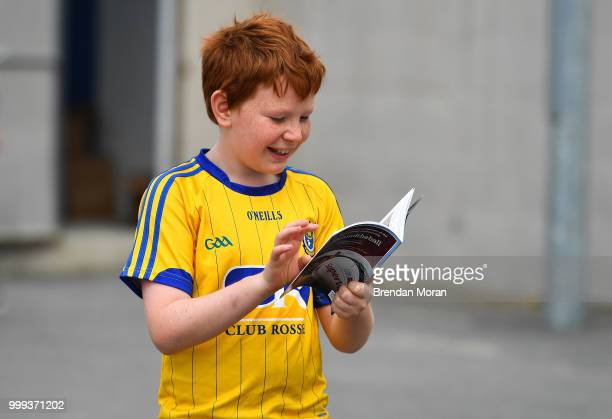 Laois Ireland 7 July 2018 A young fan checks out his match programmes prior to the GAA Football AllIreland Senior Championship Round 4 match between...