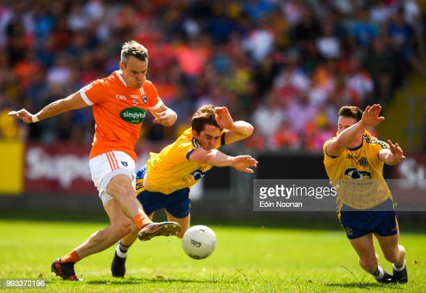 Laois Ireland 7 July 2018 Mark Shields of Armagh scores his side's first goal despite the attention of David Murray and Seán McDermott of Roscommon...