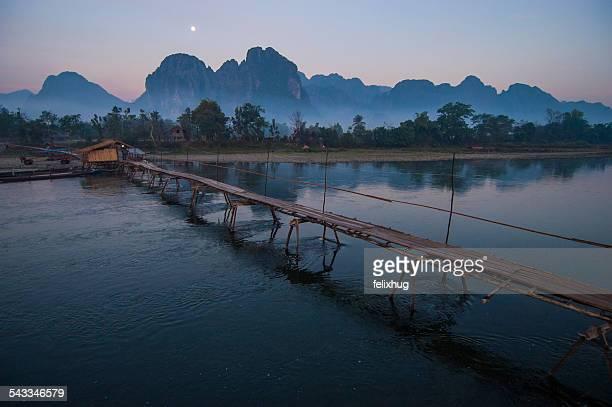 Laos, Mekong River, Bamboo bridge in at dusk