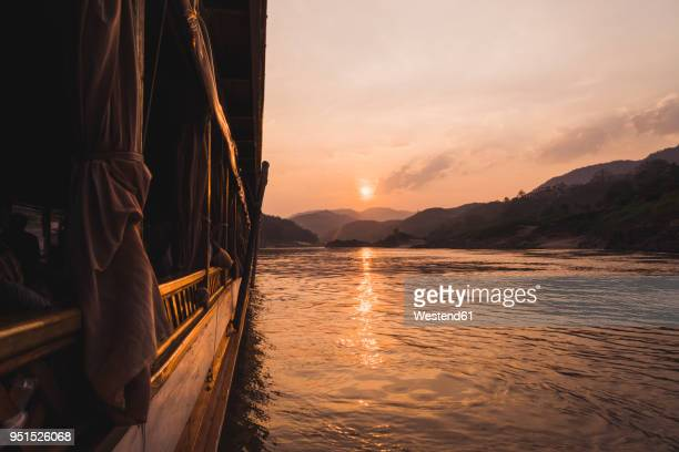 Laos, Mekong river, boat at sunset