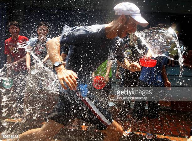 Laos people splash water on tourists during the Songkran festival on April 13 in Luang Prabang Laos The Songkran Festival runs from April 13 April 15...