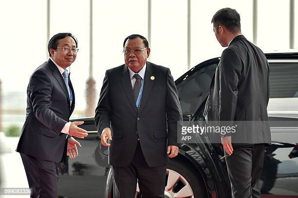 Laos' President Bounnhang Vorachith arrives at the G20 Summit at the International Expo Center in Hangzhou on September 4, 2016. G20 leaders confront...