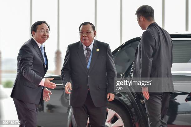Laos President Bounnhang Vorachith arrives at the Hangzhou Exhibition Center to participate in the G20 Summit in Hangzhou on September 4, 2016. G20...