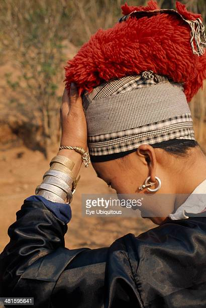 Laos Tribal People Meo Tribe Young Meo bride wearing jewelry and an elaborate red headdress in preparation for her wedding