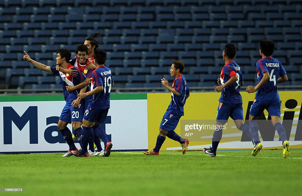 Laos's player Khampheng Sayavutthi (L) celebrates a goal with teammates against Indonesia during their AFF Suzuki Cup group B football match in Bukit Jalil Stadium outside Kuala Lumpur on November 25, 2012.