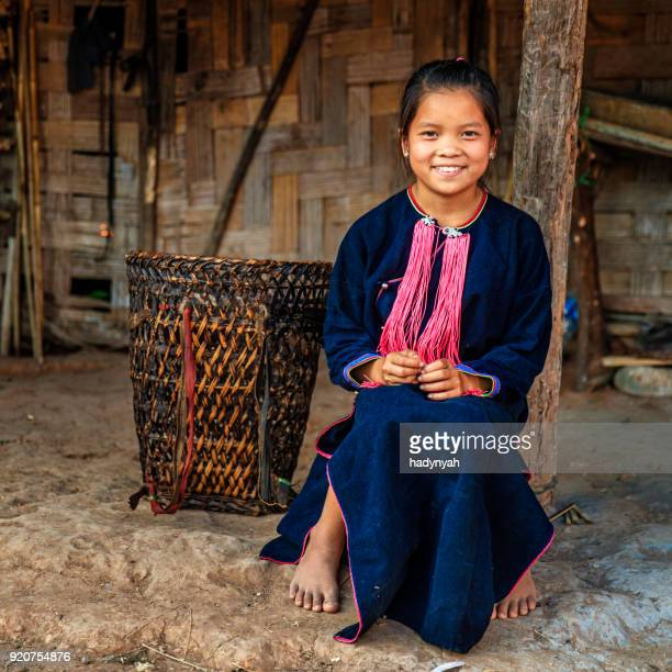 laotian little girl carrying a basket in a village in northern laos - laos stock pictures, royalty-free photos & images