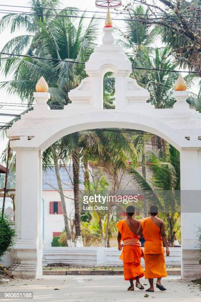 laotian monks at buddhist monastery - dafos stock photos and pictures