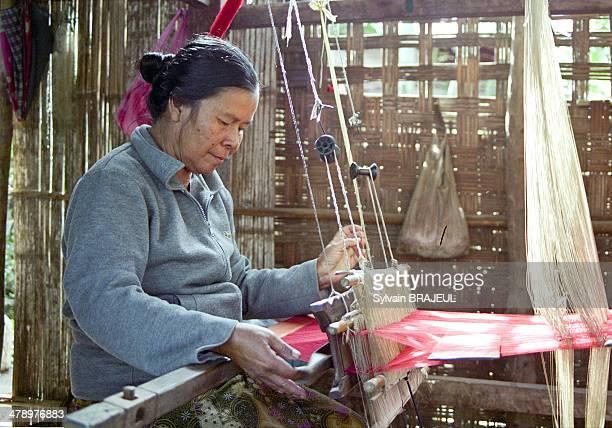Laotian woman weaves silk in Luang Prabang Laos