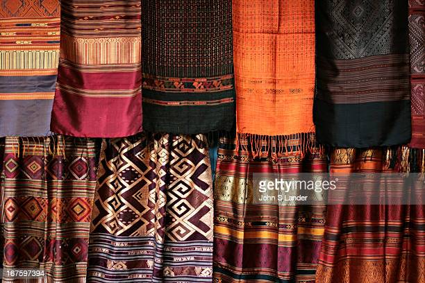 Laotian women weave these beautiful textiles on looms out of pure silk an important cultural and financial part of traditional village life Most of...