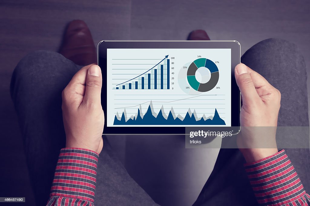 Lap point of view of man holding tablet : Stock Photo
